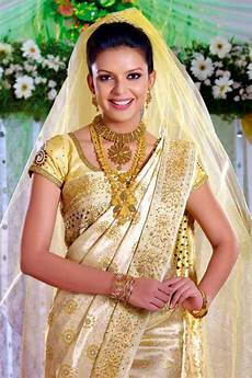 kerala bride in simple traditional marrychoice com kasavu sari for kerala brides
