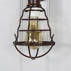 rustic industrial caged metal wall light melody maison 174