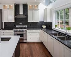Kitchen Backsplash Black Countertop by White Hanging Cabinet Finish Patterned Black Granite