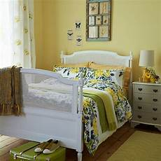Yellow And Green Bedroom Decorating Ideas by Yellow Bedroom With White Bed And Florals Bedroom
