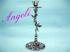 candeliere antico candeliere argento angeli angioletti porta candela candle