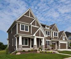 the lap siding shakes lighting block and garage doors are sherwin williams sw7027 well bred