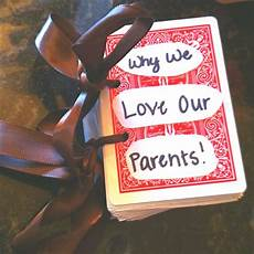 cool anniversary gift idea for parents from kids buy a deck of cards and punch two holes