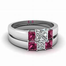 dainty 3 stone princess cut wedding ring with pink