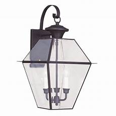 livex lighting 3 light bronze outdoor wall lantern with clear beveled glass 2381 07 the home depot