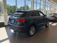 Rear Angled View Of The 2018 Audi Q3 In Daytona Grey Pearl