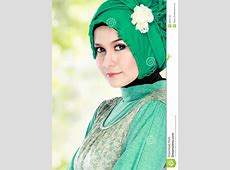 Young Happy Beautiful Muslim Woman With Green Costume
