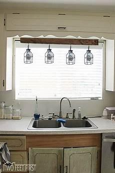 lighting above kitchen sink inspiration twofeetfirst