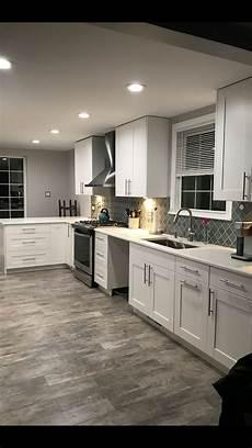this exact color scheme white cabinets white trim light gray farmhouse kitchen
