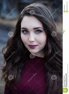 girl with black hair blue eyes portrait of a blue eyed girl with dark hair in cherry clothes stock photo image of darkhaired