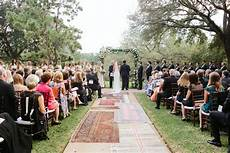 A Bohemian Wedding Trend We Re Loving Ceremony Aisles With Rugs