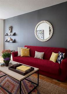 how to match a room s colors with bold fabric red couch living room red couch rooms living