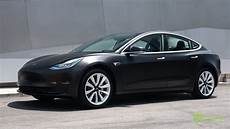 tesla model 3 black black tesla model 3 customized with satin black wrap and