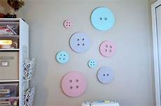 diy button wall art for a sewing craft room create and