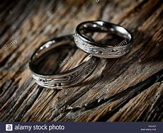two white gold wedding rings with celtic design rustic