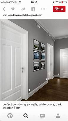 love the combination of grey walls with white doorframe