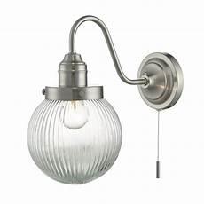 dar lighting tamara single light wall fitting in satin nickel finish complete with glass shade