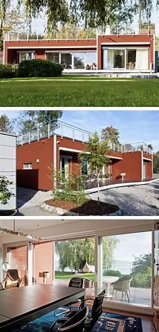 flachdach bungalow mit holzfassade haus am see