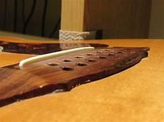 how to fix a guitar bridge guild 12 string acoustic bridge re glue south guitar repair
