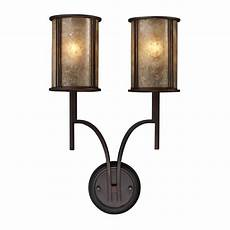 sconce wall light with brown mica shades in aged bronze