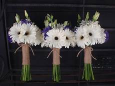 white gerbera bouquets with purple lisianthus and twine wrap wedding flowers
