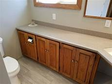 corian bathroom bathroom with corian shower and heated tile floor