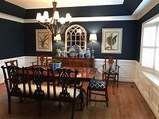my dining room with sherwin williams naval paint color blue and white pottery and