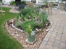 beet mit steinen anlegen update the herb spiral gardeninggrrl