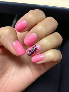 pink shellac nails with feather design on ring fingers