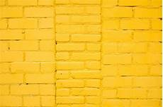 bright yellow brick wall background in rural room photo premium download