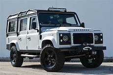 this custom land rover defender is a bone white maxim