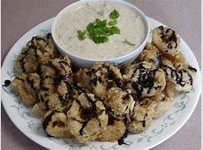 fried calamari with remoulade sauce drizzled with balsamic syrup_image