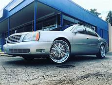 wow check out this 2004 cadillac deville sitting