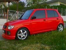Red Daihatsu L701 Mira / Cuore  Cuores