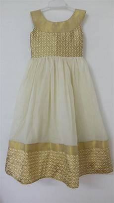 onam special dresses for girls onam pecial gold and cream combination frocks for girls