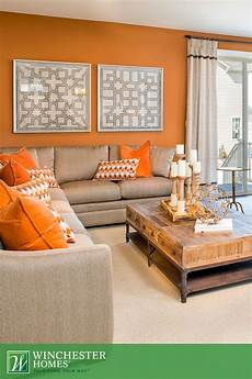 orange walls patterned artwork and light carpets add to the perceived space of the barrington