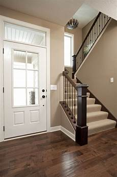 love the color of the walls for the entry way maybe make thee door a dark brown to match the