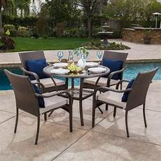 outdoor dining furniture outdoor brown wicker 5 dining set with beige