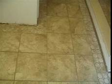 like the tile border and the floor powder ceramic tile shower stall and bathroom floor with a mosaic