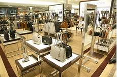 dayton business retailer michael kors to 100 stores