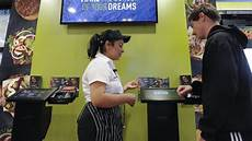helps customer michael slade 16 order a customized sandwich using a tablet at a