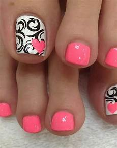 coral with black and white accent nail pretty toe