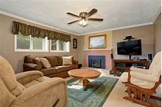 typical american living room with brown couch and