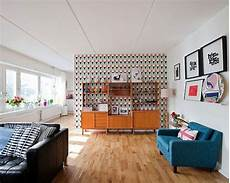 a mid century inspired apartment with modern geometric mid century living room with geometric wallpaper retro