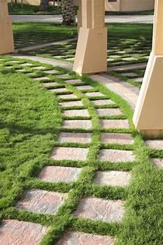 alte waschbetonplatten verschönern beautiful grass decorated path in a garden stock photo