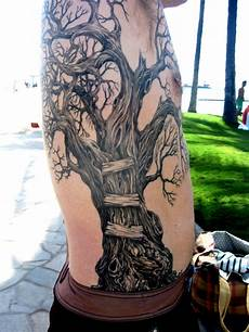 slip with snak trees tree trimmers a tree tattoo
