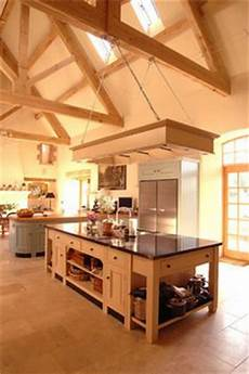 light rafters and beams with warmly painted walls complement the light kitchen perfectly