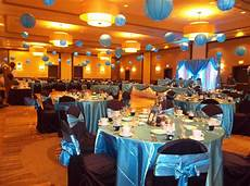 malibu blue wedding with black chair covers and lighted lanterns heavenly creations events