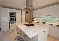 this stylish white kitchen island with breakfast bar seats