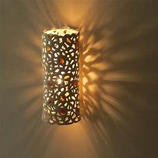 a ceramic cylinder wall light with yellow and orange